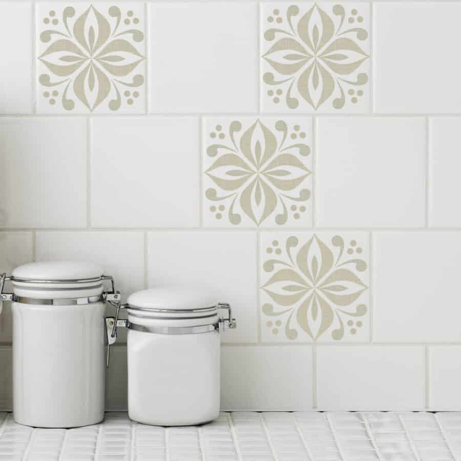 Floral medallion tile stickers in a soft sand color cover white tiles in a kitchen setting.