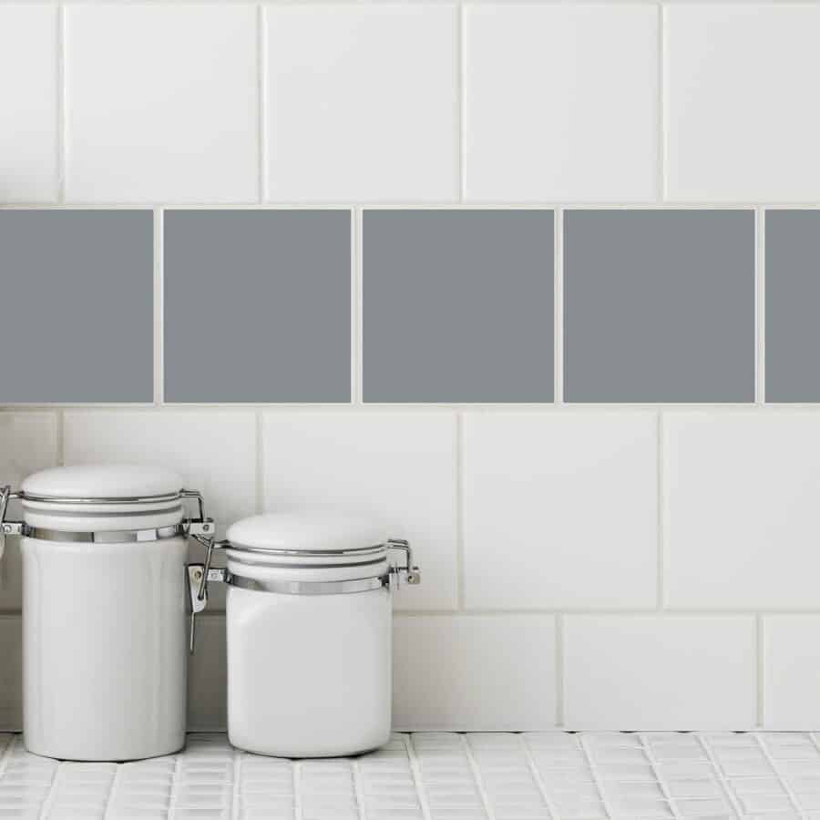 Gray square tile sticker cover white tiles in a kitchen setting.