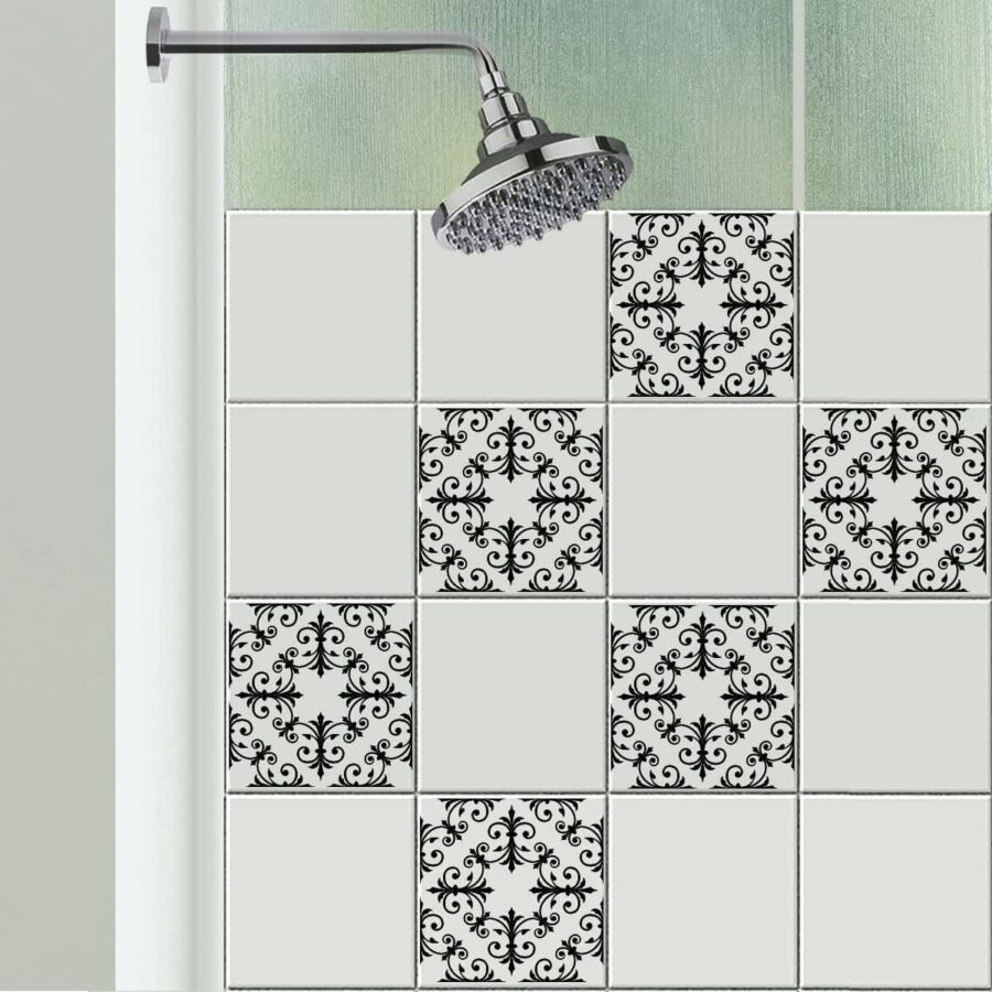 Initricate geometric squares on tile stickers adorn a shower tile wall.