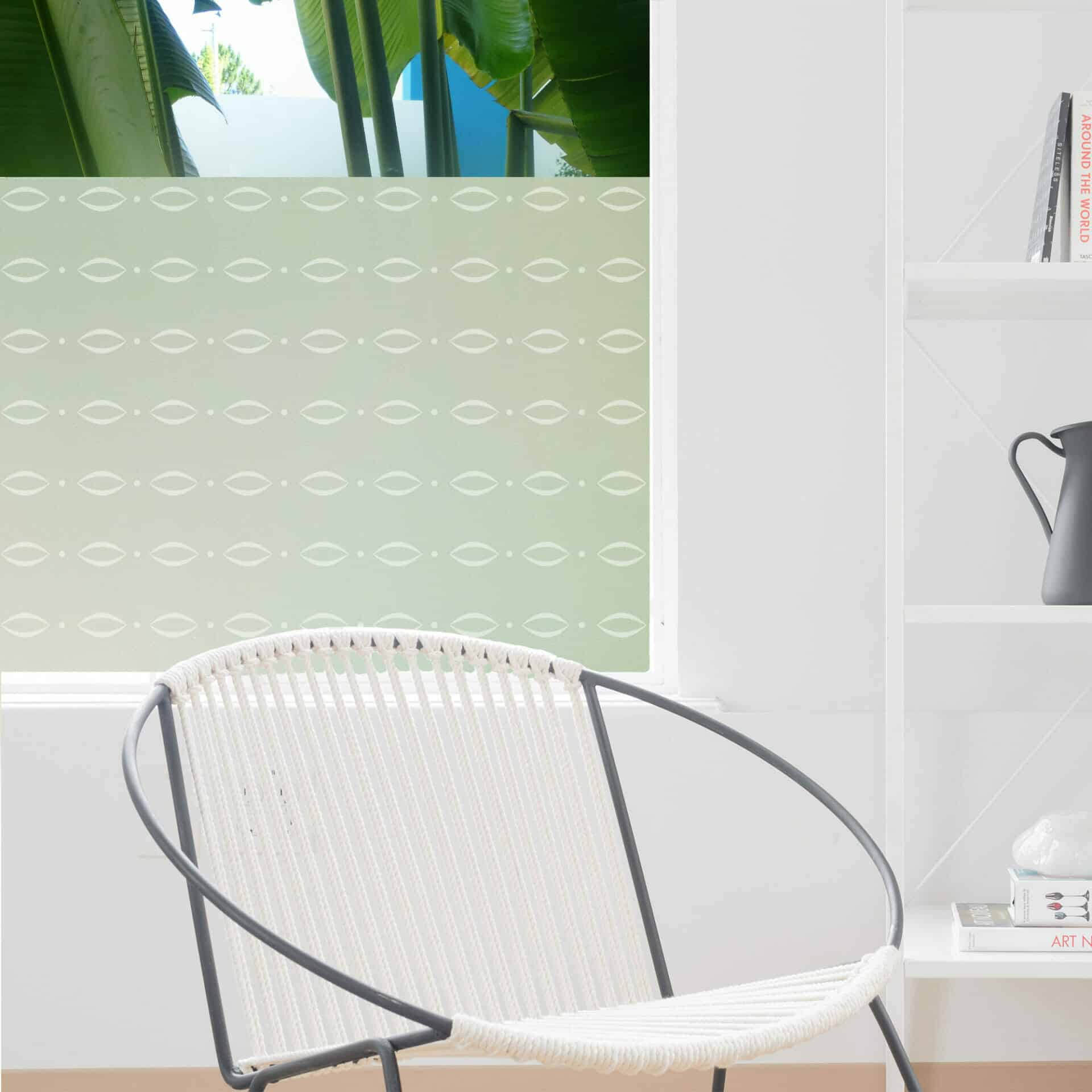 Window privacy film featuring delicate eyebrow-shaped curves and dots in linear lines.