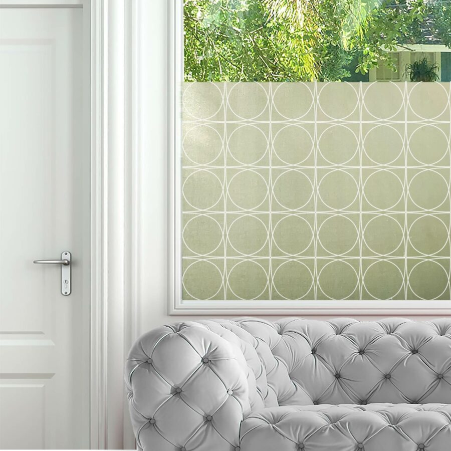 Circular iron fretwork privacy window film pattern in white.