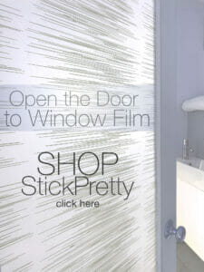 Window privacy film on a bathroom door creates privacy and features a pattern of contemporary slightly sporadic horizontal lines.