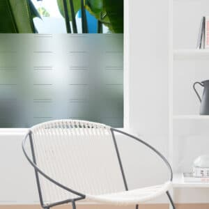 Contemporary room features large window with frosted window film. The film is decorated with broken horizontal lines.